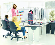 Designer and his team choose the fabric for clothes stock image