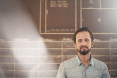 Designer in his workshop studio looking confidently at the camer Royalty Free Stock Photography