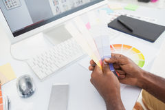 Designer holding colour sample and choosing Stock Photos