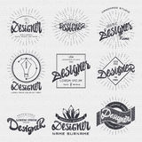 Designer - Insignia sticker can be used as a finished logo, or design, corporate identity presentation. Designer - calligraphic writing the word, lettering Stock Photos