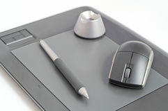 Designer kit. Pen and mouse on designer pen tablet Royalty Free Stock Images
