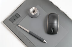 Designer kit. Pen and mouse on designer pen tablet Stock Photos