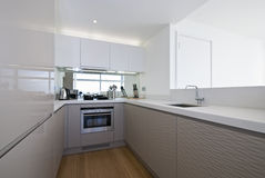 Designer kitchen in white. Designer kitchen with modern appliances in white Royalty Free Stock Photo