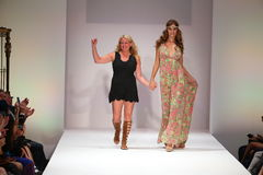 Designer Lainy Gold and model walks the runway finale at the Lainy Gold Swimwear fashion show Stock Photos