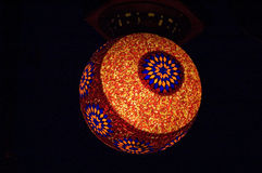 Designer Lamp. A beautiful lamp with colorful artistic designs on it isolated on a black background Stock Photos