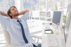Designer leaning back at his desk Royalty Free Stock Images