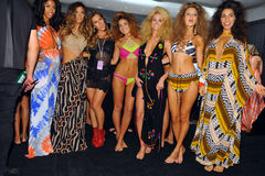 Designer Libby De Santis (C) and models posing backstage at the Indah fashion show during MBFW Swim 2015 Royalty Free Stock Photos