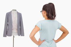 Designer looking at her mannequin Royalty Free Stock Photo