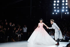 Designer Ly Qui Khanh and model walks runway at the New York Life show during MBFW Fall 2015 Stock Images