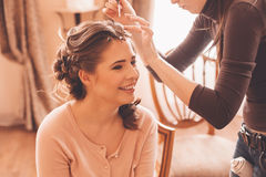 Designer making hairstyle for bride Royalty Free Stock Photography