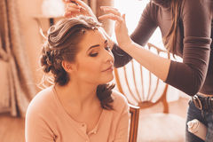 Designer making hairstyle for woman Royalty Free Stock Image