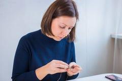 Designer making handmade brooch royalty free stock image