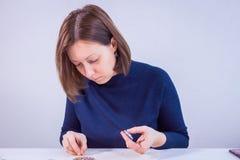 Designer making handmade brooch royalty free stock photography