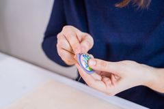 Designer making handmade brooch stock photo