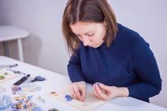 Designer making handmade eardrop Stock Photo