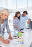Designer making plan in her bright office Royalty Free Stock Photos