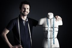 Designer man. Portrait of a man fashion designer working with dummy at studio Royalty Free Stock Images