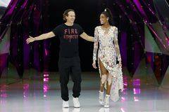 Designer Manuel Facchini and model Winnie Harlow acknowledge the applause of the audience after the Byblos show. MILAN, ITALY - FEBRUARY 20: Designer Manuel stock photography