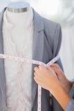 Designer measuring blazer. With measuring tape stock photography