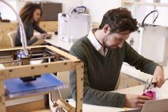 Designer Measuring Model In 3D Design Studio Stock Photos