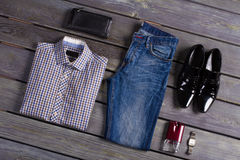 Designer men's clothing. Designer men's clothing on a dark wooden background Royalty Free Stock Images