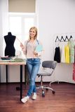 Designer with notebook and pencil standing in workshop Royalty Free Stock Images