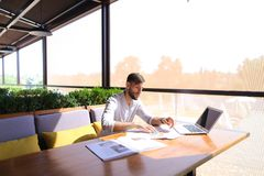 Free Designer Of Engineering Systems Working With Laptop And Document Stock Photos - 109983043