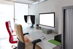 Designer office desk with computer screens royalty free stock photography