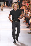 Designer Peter Dundas walks the runway after the Roberto Cavalli fashion show Royalty Free Stock Photography