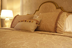 Designer pillows on the bed Royalty Free Stock Image