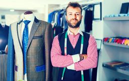 Designer is pleased by created image. In man shop stock images