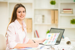 Designer. Portrait of young beautiful designer working with color samples in her office Stock Images