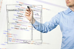 Designer presents website development wireframe Stock Photography