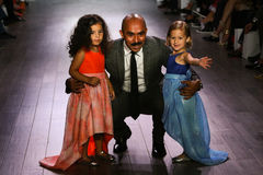 Designer Raul Penaranda and kid models walk the runway at Raul Penaranda fashion show. NEW YORK, NY - SEPTEMBER 16: Designer Raul Penaranda and kid models walk Stock Image