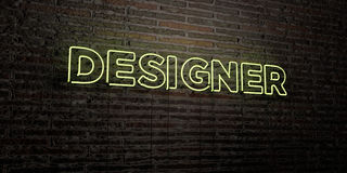 DESIGNER -Realistic Neon Sign on Brick Wall background - 3D rendered royalty free stock image Stock Photography