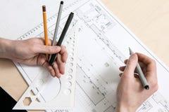 Designer`s hands working on scheme stock photos