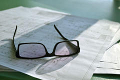 Designer's plot. On a table with glasses in a natural light Royalty Free Stock Photography