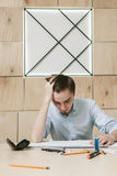 Designer`s problem and stress, brainstorm concept. Designer`s problem and stress, brainstorm, new invention concept. Brainwork in office. Young man intencively royalty free stock photo