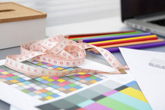 Designer's table with blank note and tools Stock Photography