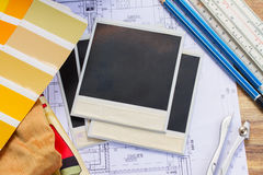 Designer's working table. Interior designer's working table, an architectural plan of the house, color palette and fabric samples in yellow shades, copy space on royalty free stock image