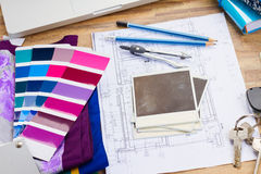 Designer's working table. Interior designer's working table, an architectural plan of the house, color palette guide and fabric samples in lilac shades, copy royalty free stock image