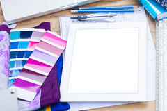 Designer's working table. Interior designer's working table, an architectural plan of the house, color palette guide and fabric samples in lilac shades, copy stock images