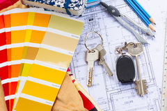 Designer's working table. Interior designer's working table, an architectural plan of the house, color palette guide and fabric samples in yellow shades stock photos