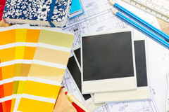 Designer's working table. Interior designer's working table, an architectural plan of the house, color palette guide and fabric samples in yellow shades, copy stock photography