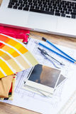 Designer's working table. Interior designer's working table, an architectural plan of the house, color palette guide and fabric samples in yellow shades, copy royalty free stock photo