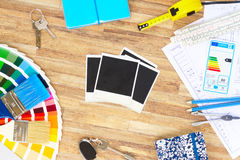 Designer's working table. Interior designer's working desktop with architectural plan of the house, color guide and brushes, copy space on blank instant photos stock images