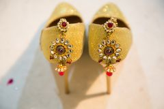 Designer Sandals Decorated with ornaments. Designer golden Indian Bridal footwear decorated with ornaments and jewelry royalty free stock photos