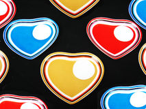 Designer Saucer Background. A background of colored heart shaped designer saucers Royalty Free Stock Photography
