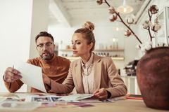 Designer showing new sketches to his assistant. royalty free stock photo