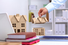 Designer shows a model of a new home Royalty Free Stock Photo